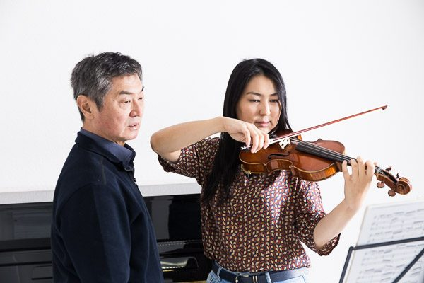 Teacher and pupil with violin